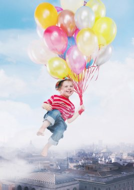 Funny image presenting kid flying by the balloons