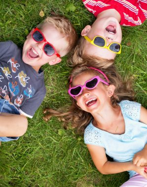 Laughing kids relaxing during summer day