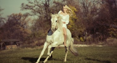 White angel riding a pure white horse