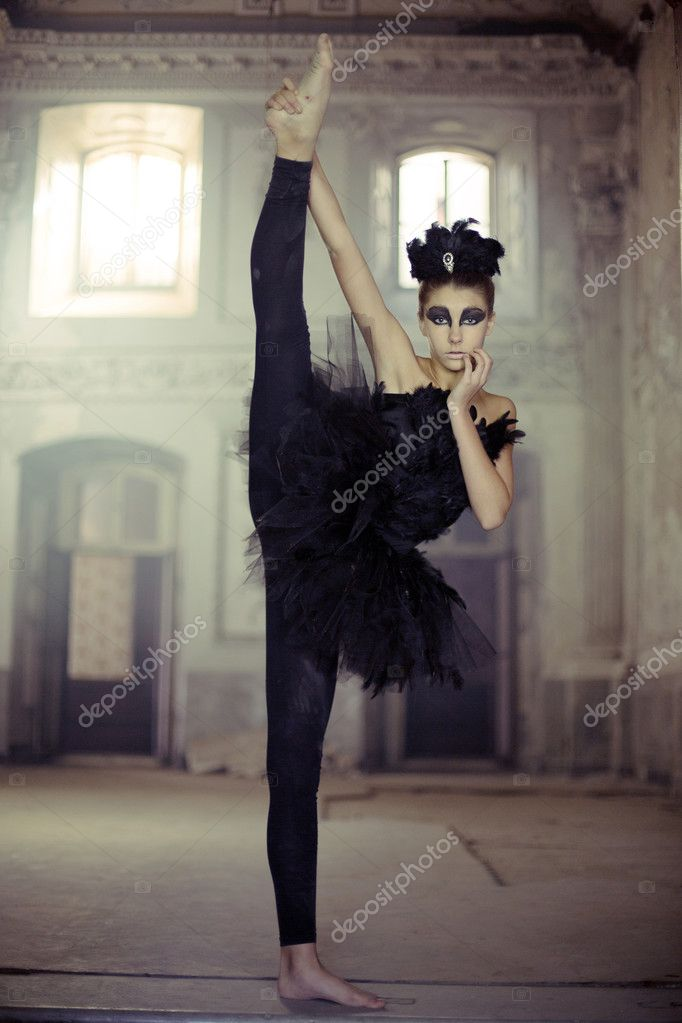 Fit young ballet dancer as a swan