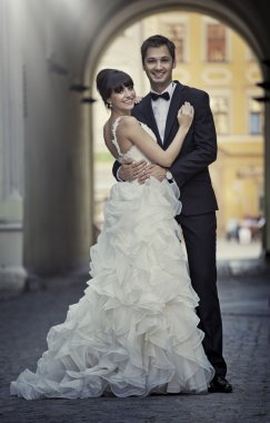 Attractive marriage couple in love pose