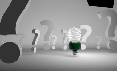 Picture of light bulb among question marks