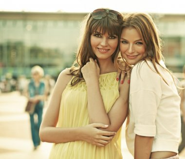 Two smiling girlfriends with summer make-up