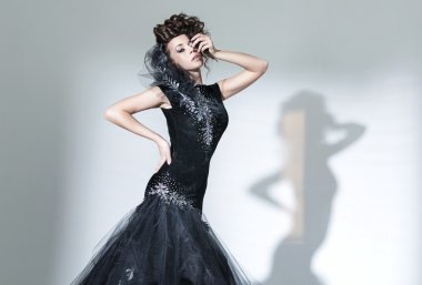 Elegant young woman wearing fancy dress