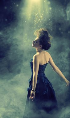 Glamour lady dancing in the fogg