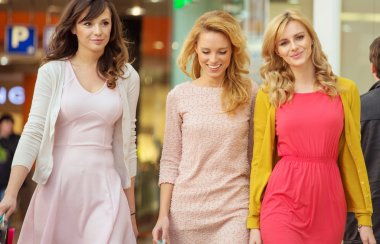 Three cheerful women in the shopping mall