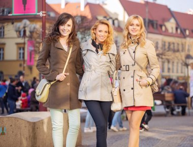 Three smart ladies in the downtown