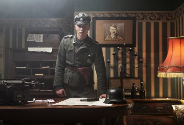 Tall blonde german soldier in his office