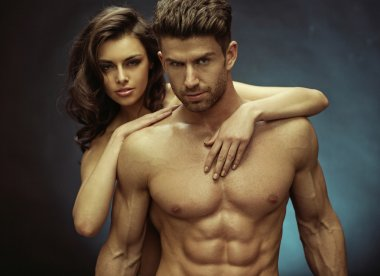 Muscular handsome man and his sensual girlfriend