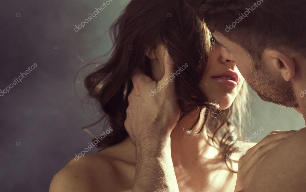 Sensual woman kissing her husband