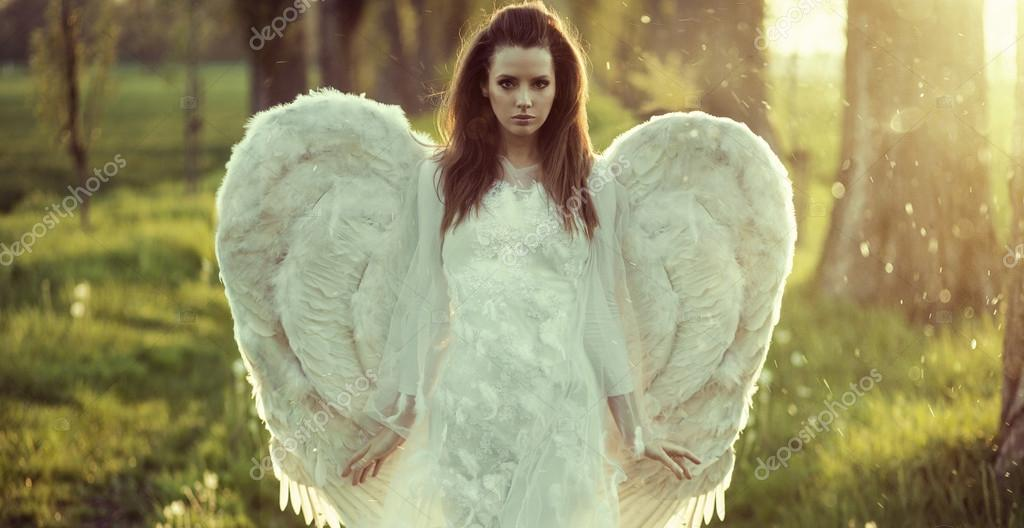 Delicate woman dressed as an angel