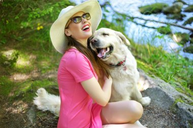 Attractive woman playing with lovely dog