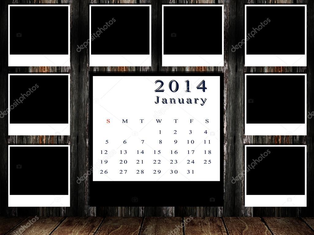 calendario 2014 prendió con marco de fotos pared grunge — Foto de ...