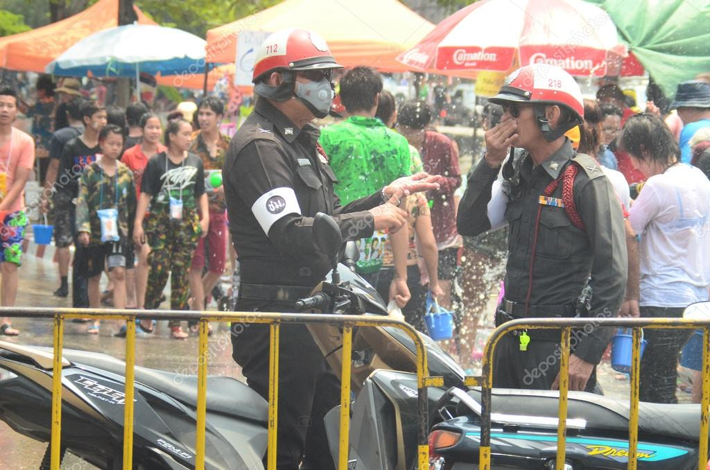 CHIANG MAI, THAILAND - APRIL 15 : Police working in water festival or Songkran festival on 15 April 2014 in Chiang Mai, Thailand