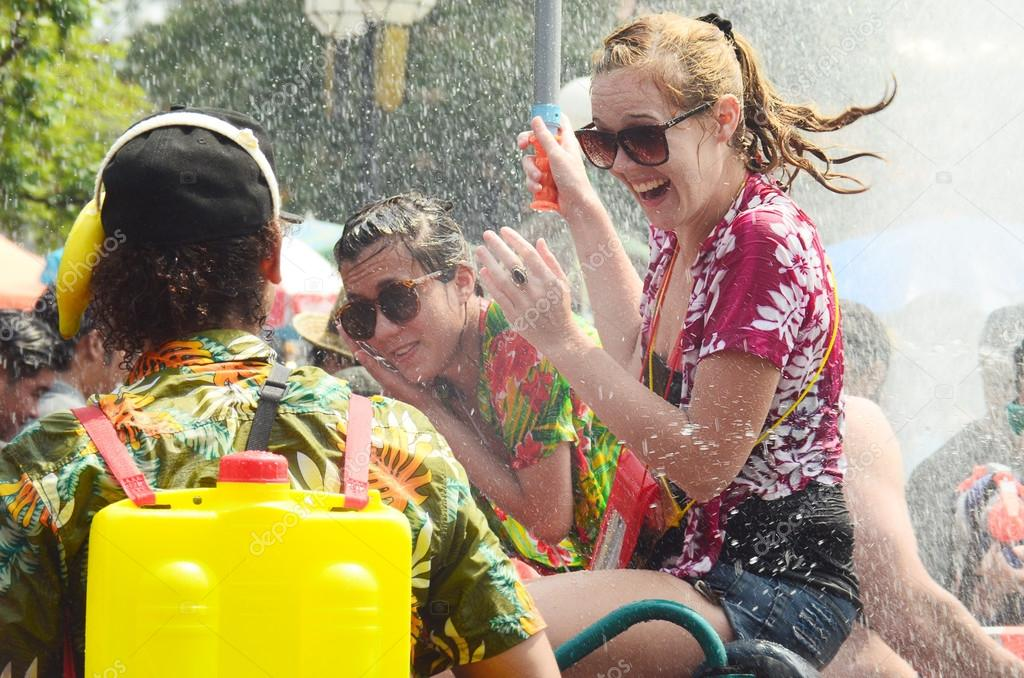 CHIANG MAI, THAILAND - APRIL 15 : People celebrating Songkran water festival in the streets by throwing water at each other on 15 April 2014 in Chiang Mai, Thailand