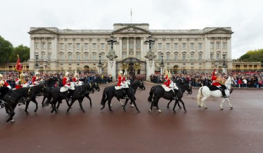 Queen's Royal Horse Guards ride past Buckingham Palace