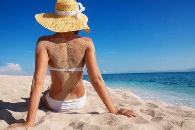 pretty woman enjoying vacation on beach