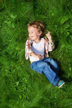 funniest kid rolling on grass