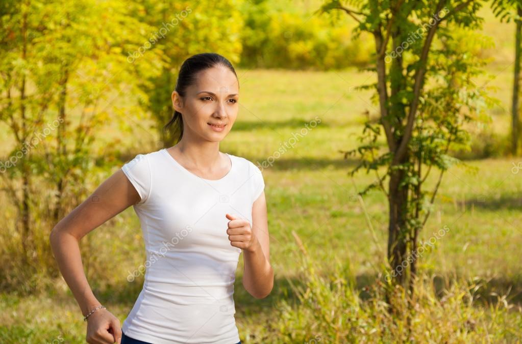 girl running in white t-shirt