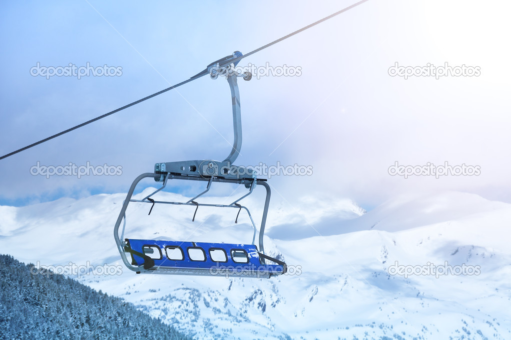Merveilleux Close Up Of Ski Lift Chair With Mountain Tops On The Background. U2014 Photo By  Serrnovik