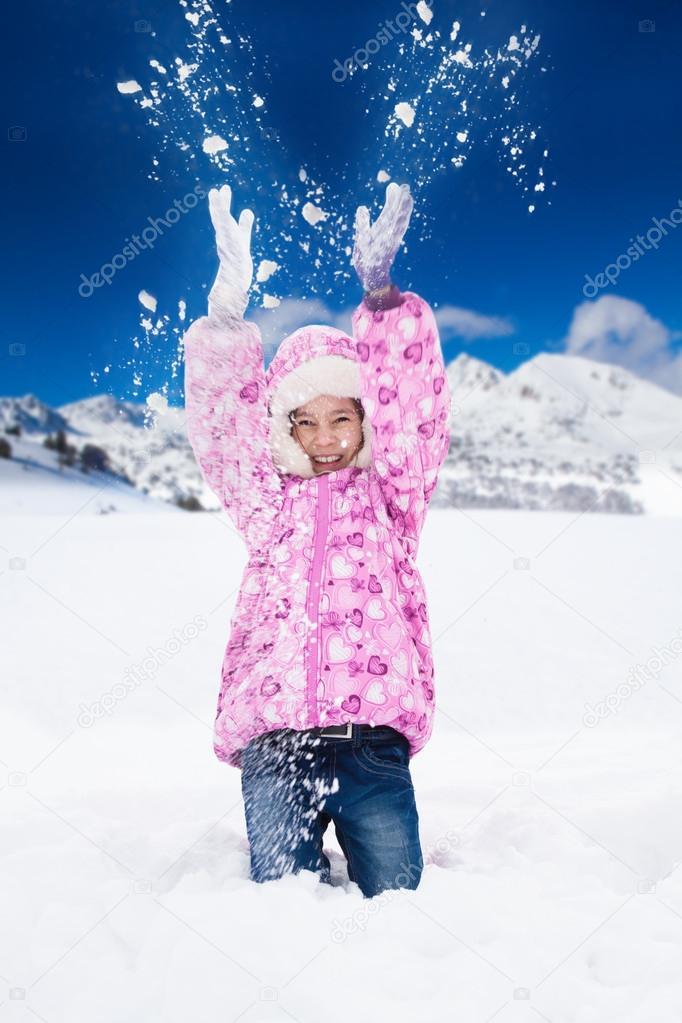 Girl throw snow