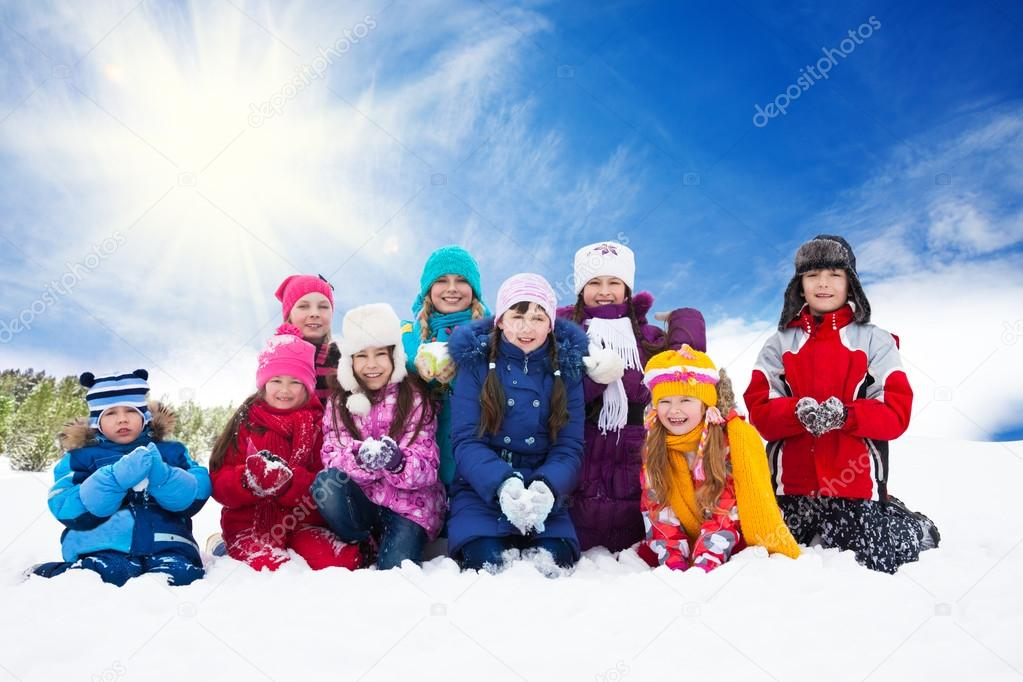 Large group of happy kids throwing snow