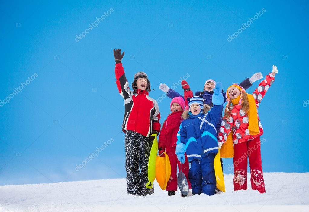 Group of kids waiving hands on snow day