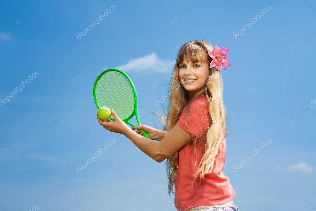 Girl with tennis rocket