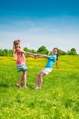 Girls dancing in the flower field