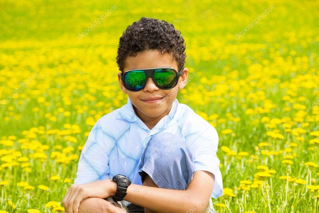 Black boy in dandelions