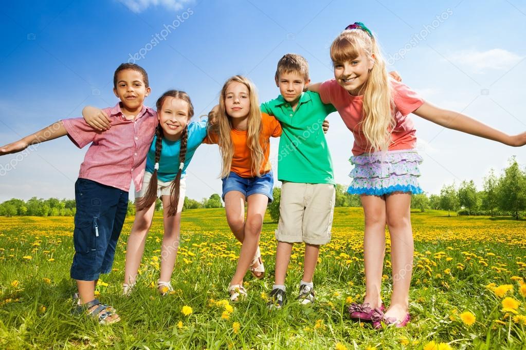 Kids hugging standing in the field