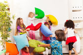 Kids playing pillow fight