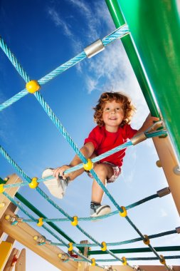 Active strong boy on playground