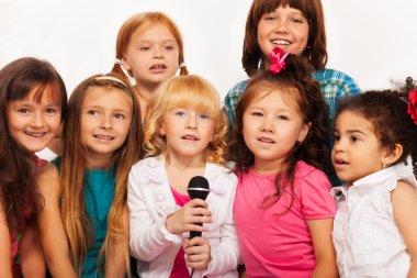 Close shots of kids singing