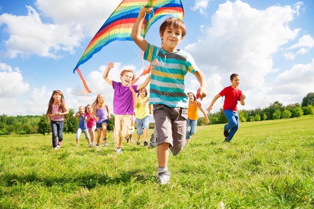 Many kids run with kite