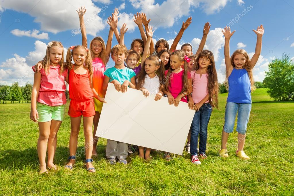 Group of kids with placecard