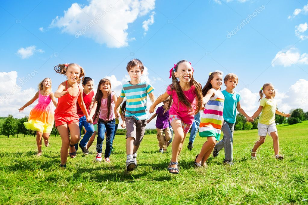 Kids running enjoying summer