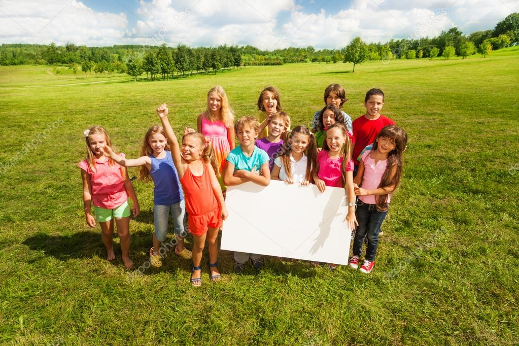 Group of kids with blank baner
