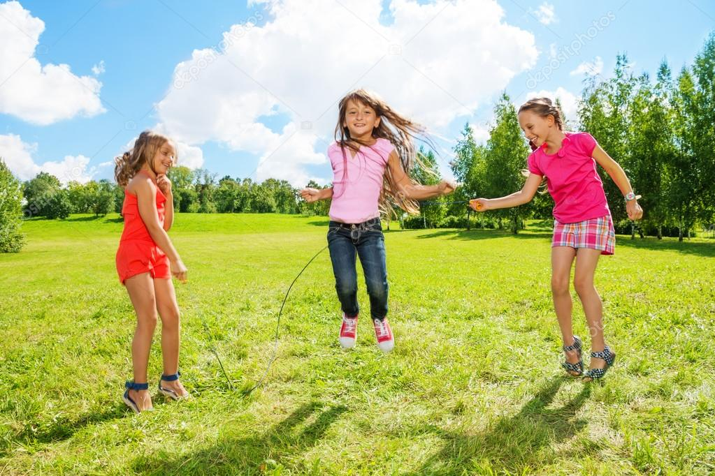 Girls play jumping over the rope