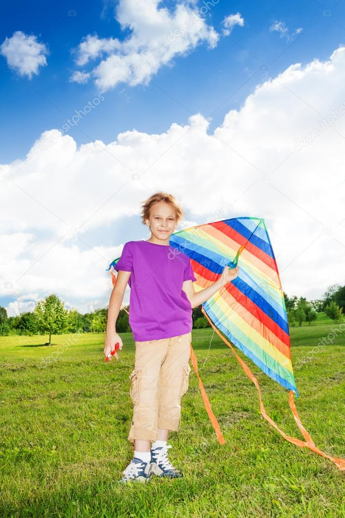 Boy stand with kite