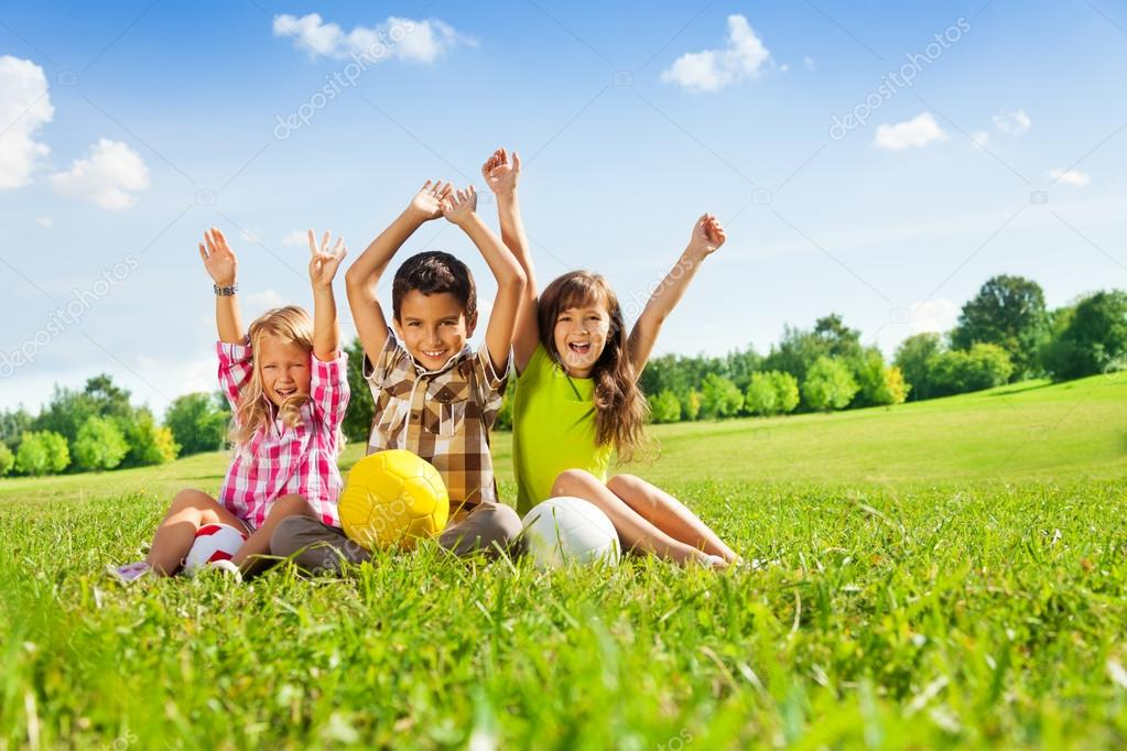 Happy kids with balls