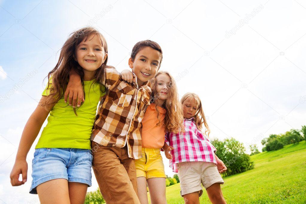 Group of hugging kids