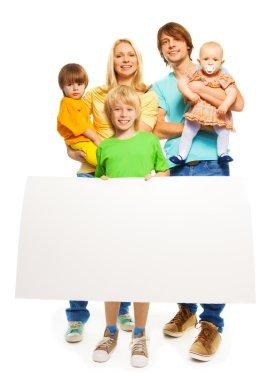 Family holding blank advertising banner