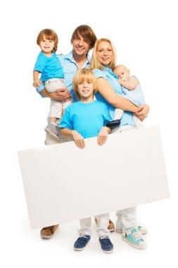 Family holding blank advertisement banner