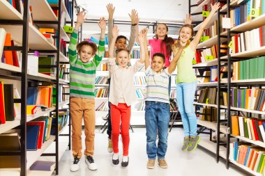 kids jumping  in  library