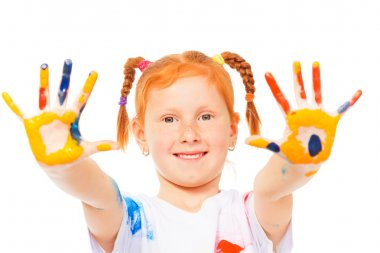 Funny little girl with ginger head shows her painted palms stock vector