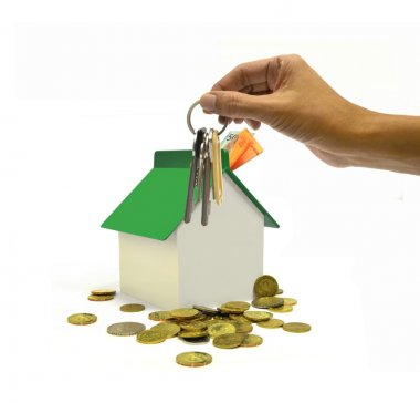 Property investment concept with hand holding bunch of keys