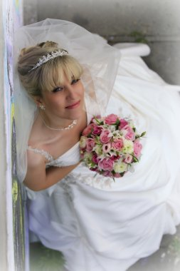 Lovely bride with bridal bouquet