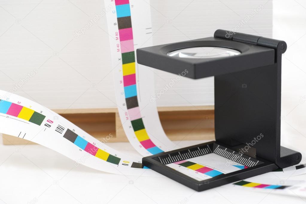 CMYK printing color bar and loupe.