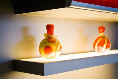 Two decorative bottles on light table on kitchen